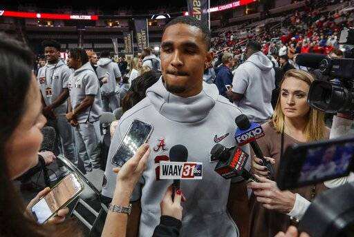 FILE - In this Jan. 5, 2019, file photo, Alabama's Jalen Hurts answers questions during media day for the NCAA college football playoff championship game, in Santa Clara, Calif. Alabama quarterback Jalen Hurts has decided to transfer to Oklahoma. Hurts made the announcement Wednesday, Jan. 16, 2019, in a story in the Players' Tribune .(AP Photo/David J. Phillip, File)