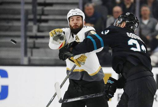 San Jose Sharks right wing Barclay Goodrow, right, and Vegas Golden Knights defenseman Deryk Engelland try to knock the puck out of the air during the second period of an NHL hockey game Thursday, Jan. 10, 2019, in Las Vegas.