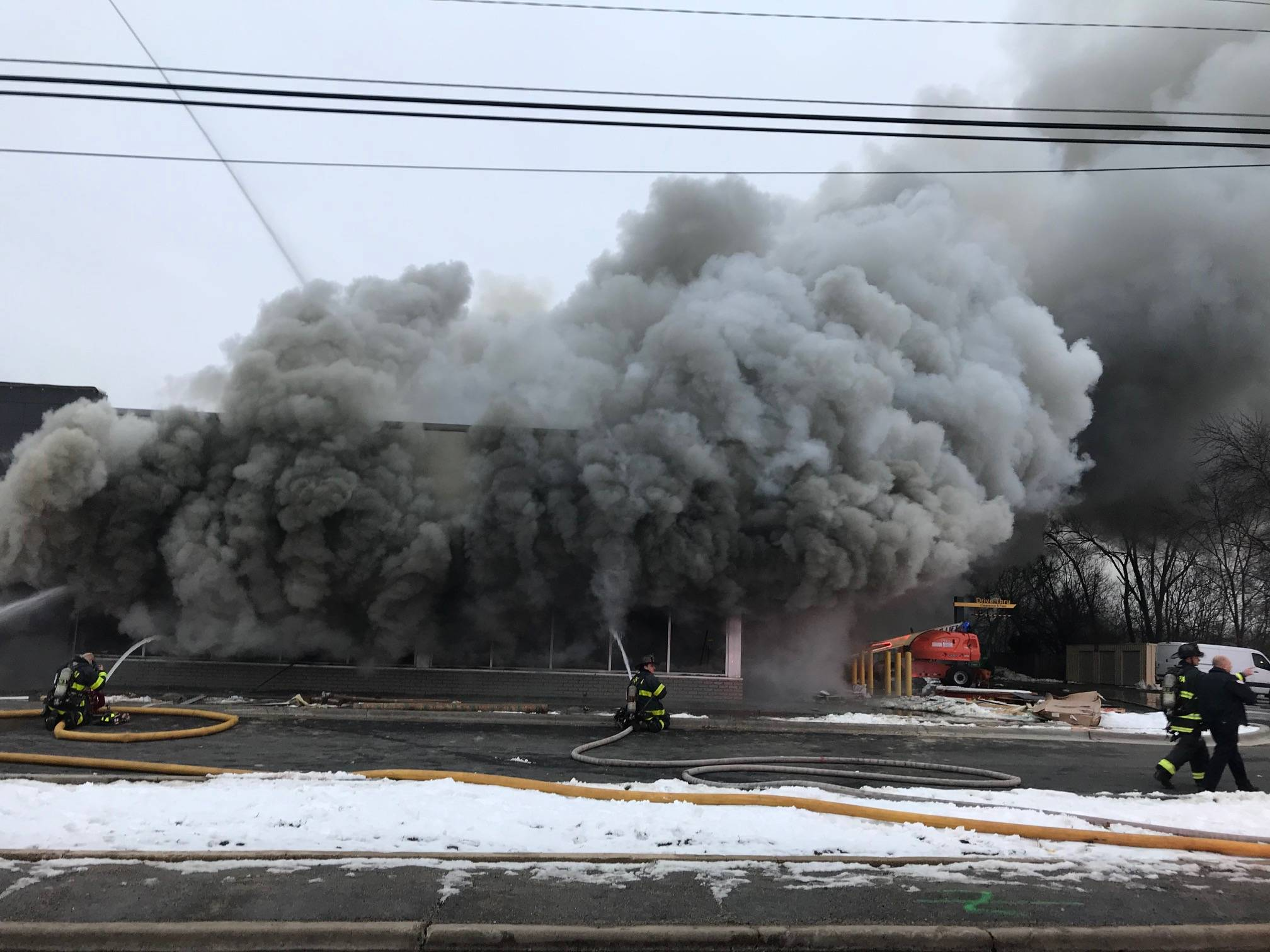 Lake Street was closed in both directions between Indian Trail and Illinois Avenue while firefighters responded to a blaze at a McDonald's under renovation.