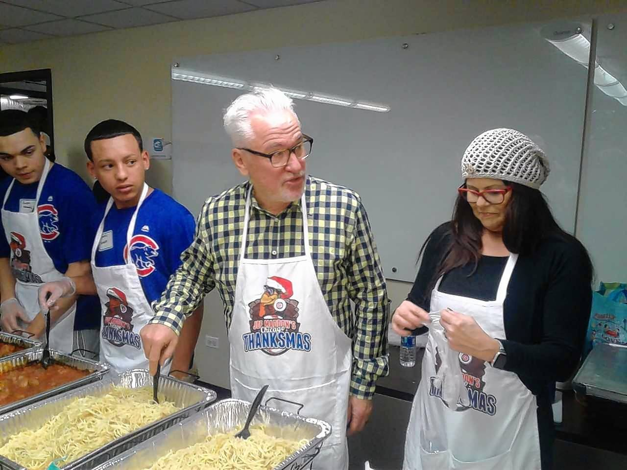 Cubs manager Joe Maddon and wife Jaye serve dinner at his Thanksmas event on Thursday at St. Leonard's Ministries on the near West Side of Chicago. Maddon said Thursday he likes the team he has coming back for 2019, despite the front office not making major moves this off-season.