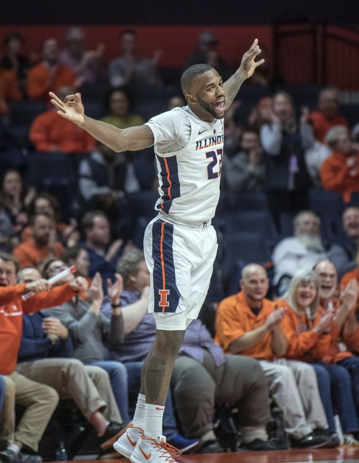 Illinois guard Aaron Jordan dances back to play defense after making a 3-pointer Wednesday during the second half against Minnesota in Champaign.