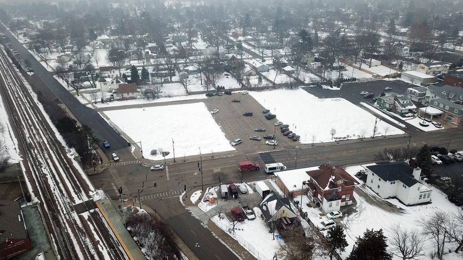 The former DuPage Theatre site in downtown Lombard was donated to the village in 1999. The theater that stood there was demolished in 2007. Now the property has a commuter parking lot sandwiched between two fields.