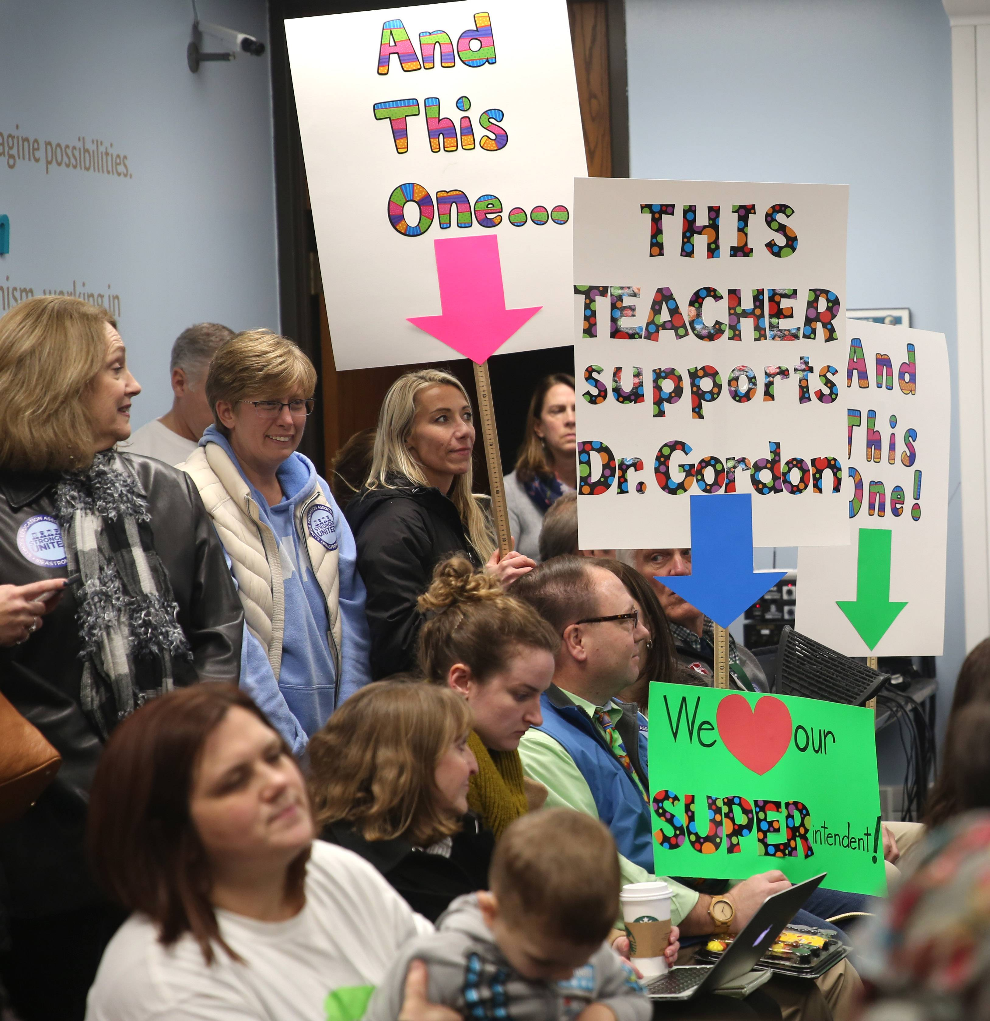 A group of demonstrators showed support for Glen Ellyn Elementary District 41 Superintendent Paul Gordon during a school board meeting in October.