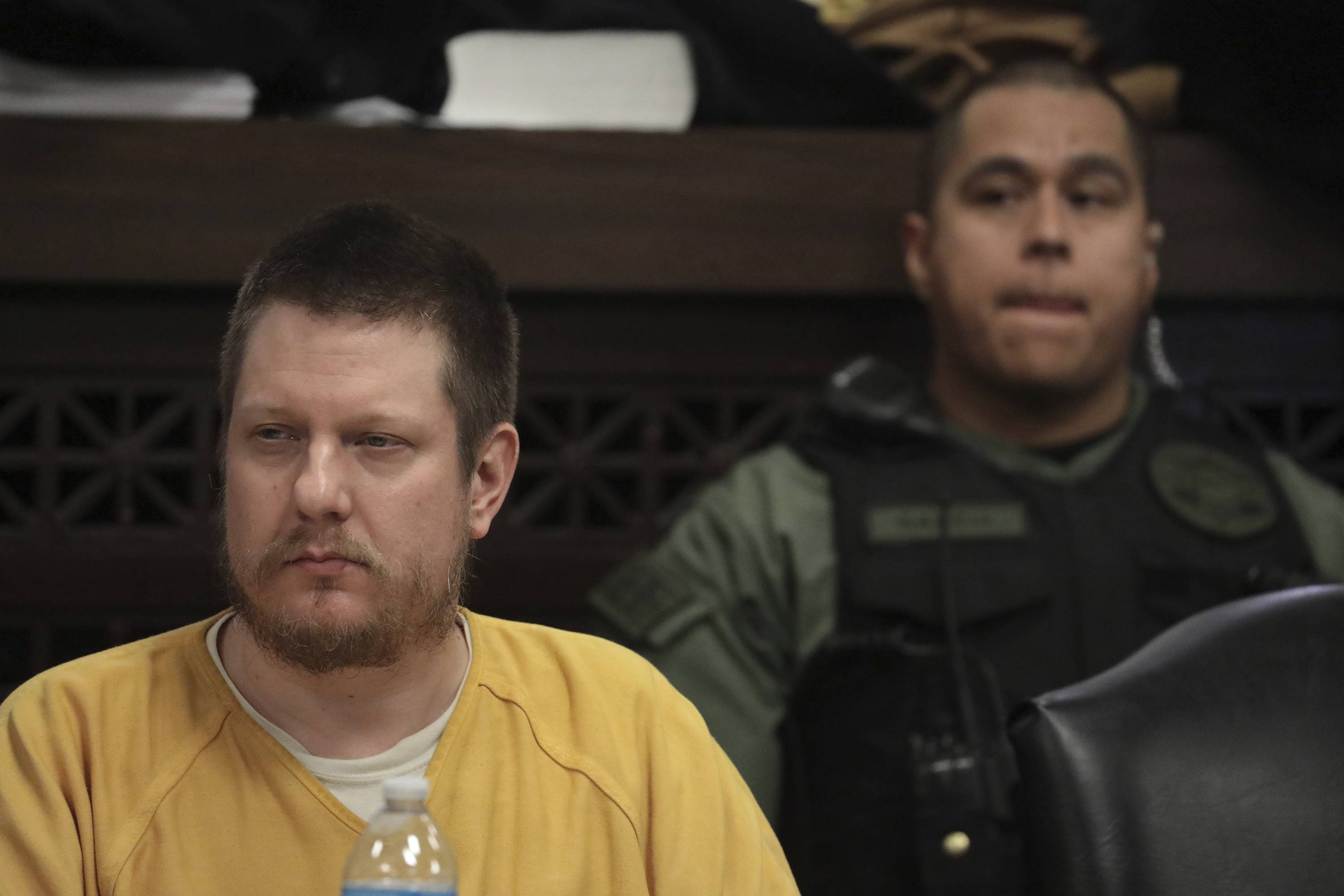 Former Chicago police officer Jason Van Dyke awaits his sentence Friday at the Leighton Criminal Court Building in Chicago. Van Dyke was convicted last year of second-degree murder and 16 counts of aggravated battery — one for each bullet fired at Laquan McDonald.