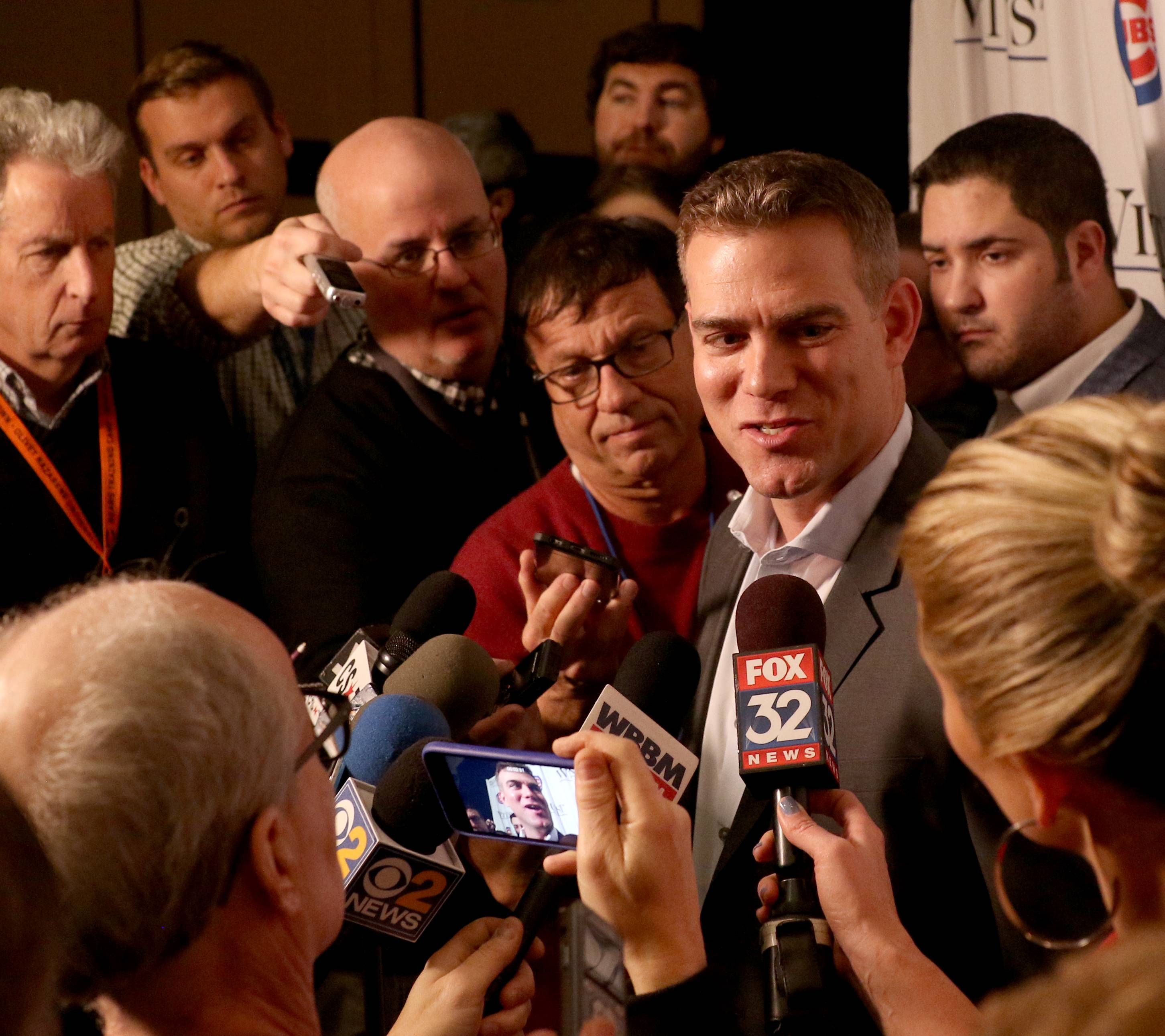 "Theo Epstein holds court for the media during opening night Friday of the 2019 Chicago Cubs Convention at the Sheraton Grand in Chicago. Suspended Chicago Cubs shortstop Addison Russell is not at the team's convention, but Theo Epstein said Friday Russell has been given a ""conditional second chance"" after his suspension for violating Major League Baseball's domestic-violence policy."