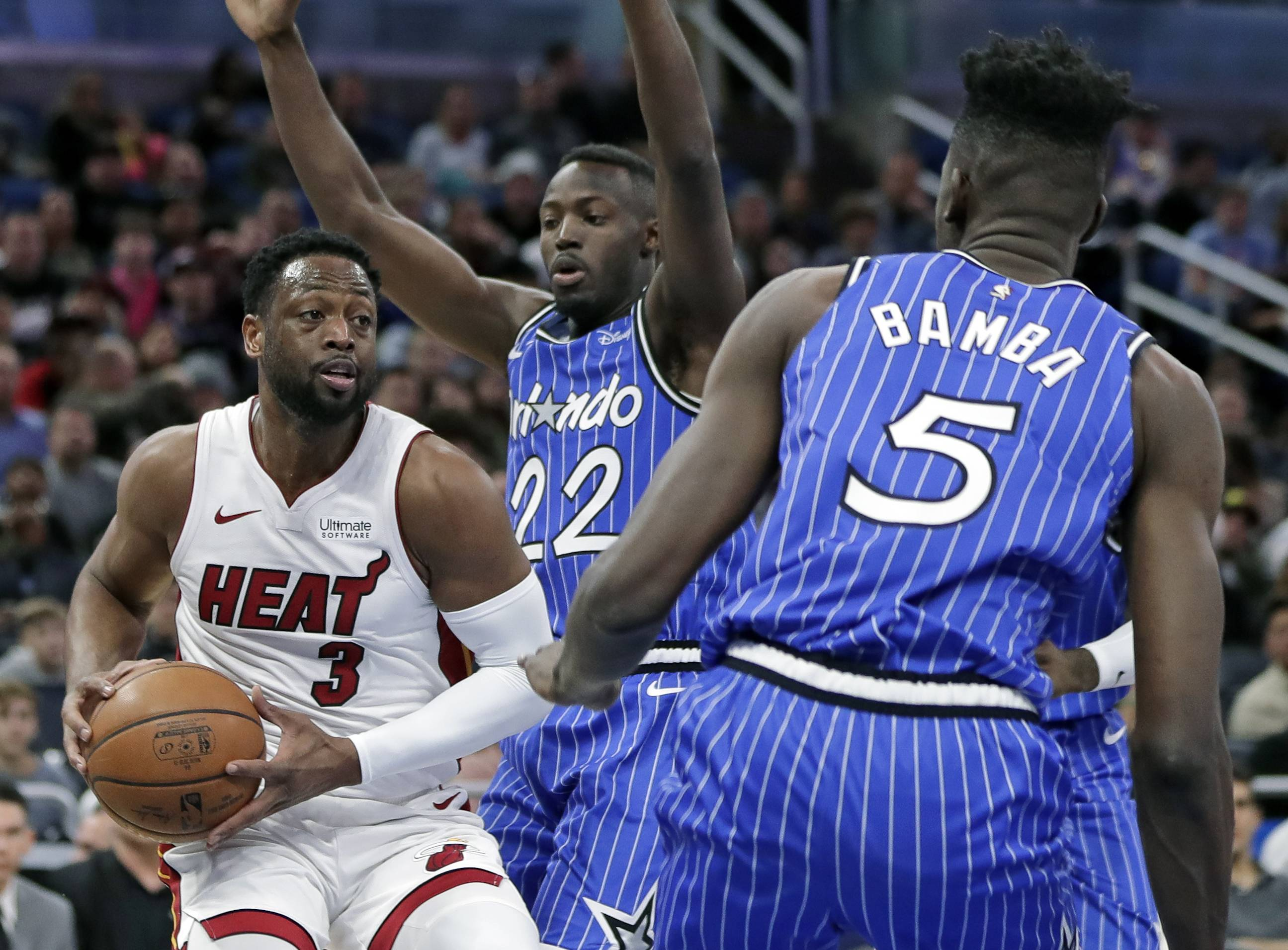 The Miami Heat's Dwyane Wade gets in a traffic jam in a December game at Orlando. He returns to the United Center for his final game in his hometown Saturday night.