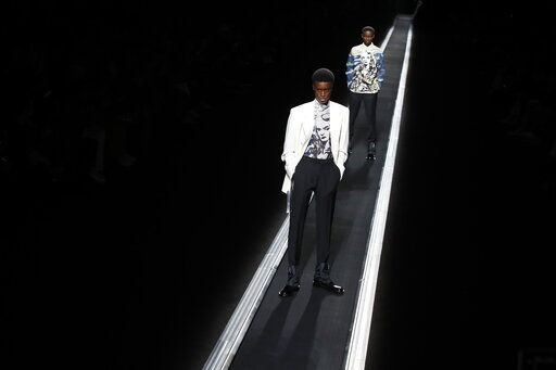 ea48f16a72f Models wear creations for the Dior men s Fall Winter 2019 20 fashion  collection presented