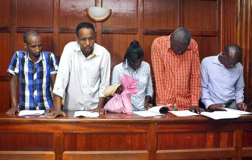 From left to right, suspects Osman Ibrahim, Guleid Abdihakim, Gladys Kaari Justus, Oliver Kanyango Muthee and Joel Nganga Wainaina appear at a hearing at Milimani law courts in Nairobi, Kenya Friday, Jan. 18, 2019. Police who are investigating this week's extremist attack on a Nairobi hotel complex asked the court that the suspects who are accused of involvement in the attack be held for 30 days in order for the police to complete their investigations, which the court granted.