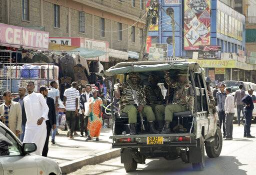Kenyan police make a routine patrol in the Eastleigh area of the capital Nairobi, Kenya, Friday, Jan. 18, 2019. Extremists stormed a luxury hotel complex in Kenya's capital on Tuesday, setting off explosions and gunning down people at cafe tables in an attack claimed by militant group al-Shabab.