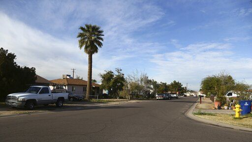 This photo shows part of South Fair Lane in Tempe, Ariz., Thursday, Jan. 17, 2019. Police in the Phoenix suburb say a burglary suspect shot to death by an officer was a 14-year-old boy carrying a replica gun.