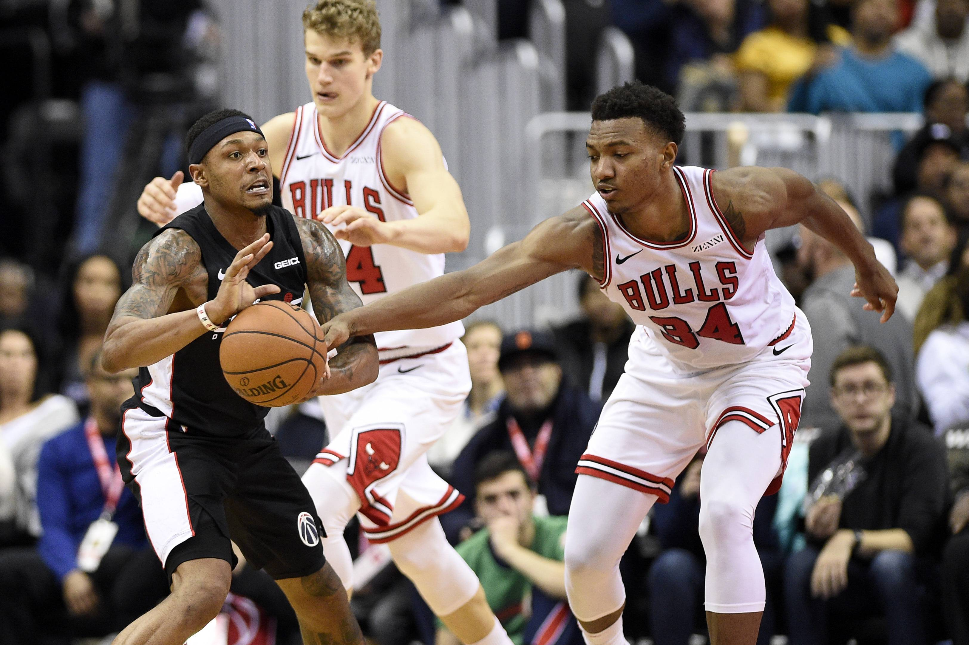 Chicago Bulls forward Wendell Carter Jr., here reaching for the ball against Washington's Bradley Beal in a game last month, could be lost for the season if he has surgery on his injured thumb.