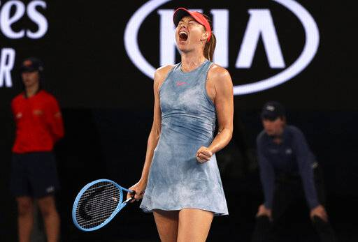 Russia's Maria Sharapova celebrates a point win over Denmark's Caroline Wozniacki during their third round match at the Australian Open tennis championships in Melbourne, Australia, Friday, Jan. 18, 2019. (AP Photo/Kin Cheung)