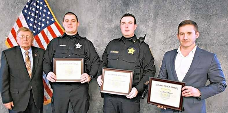 Attorney Jason Howard, right, teamed with Lake in the Hills police officer Brian Anderson, second from left, and Sgt. Matthew Mannino, third from left, to save a woman from drowning in June. With them at a recent awards ceremony is Lake in the Hills Village President Russ Ruzanski.