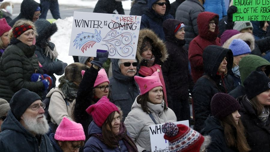 All sorts of signs dotted the crowd Saturday during the Fox Valley Women's March in Geneva. The rally started at the Kane County Courthouse and participants marched to South Street.