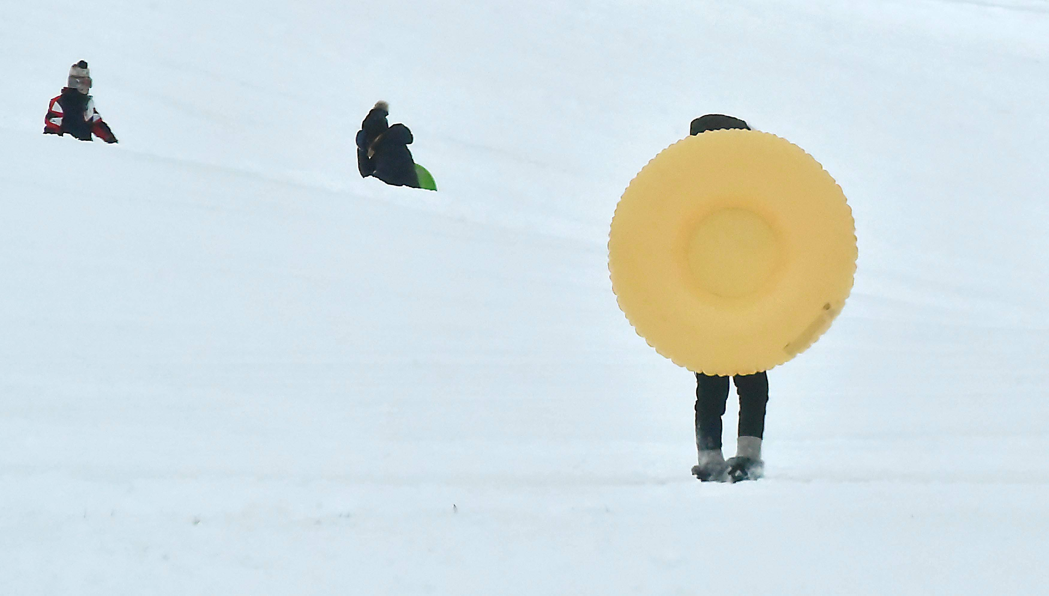 Carpenter Park in Island Lake was a popular place for sledding Saturday.