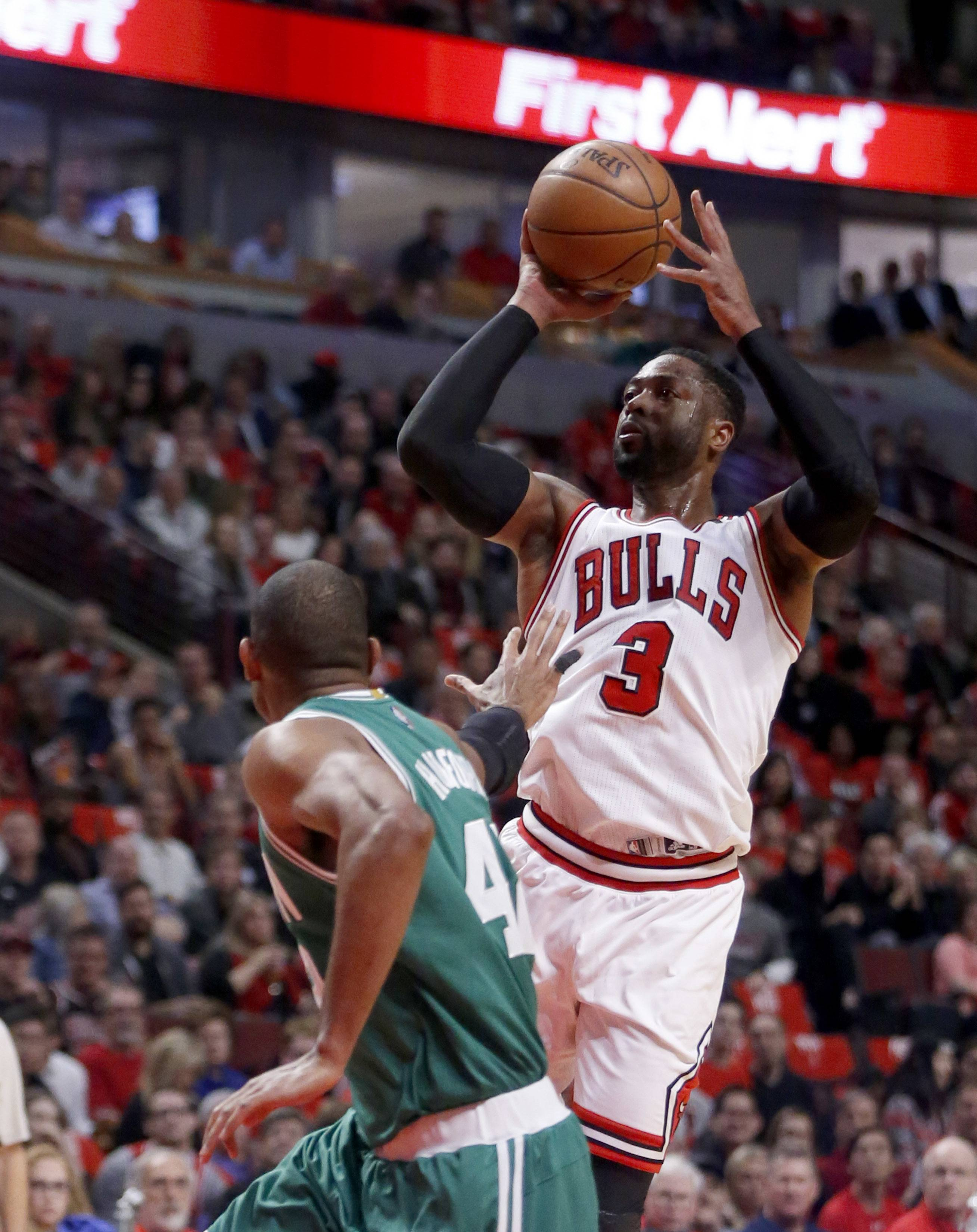 Chicago Bulls' Dwyane Wade (3) shoots over Boston Celtics' Al Horford during the first quarter of Game 3 of a first-round NBA basketball playoff series in Chicago, Friday, April 21, 2017. (AP Photo/Charles Rex Arbogast)