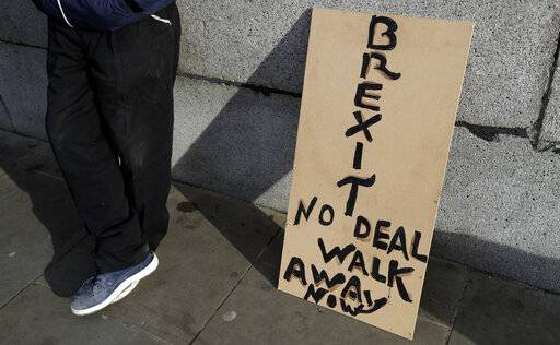 A banner leans on a wall near to parliament in London, Friday, Jan. 18, 2019. Talks to end Britain's Brexit stalemate appeared deadlocked Friday, with neither Prime Minister Theresa May nor the main opposition leader shifting from their entrenched positions. (AP Photo/Kirsty Wigglesworth)