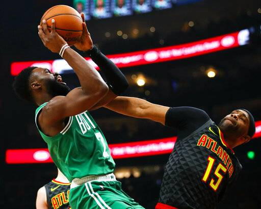 Boston Celtics guard Jaylen Brown (7) shoots as Atlanta Hawks forward Vince Carter (15) defends in the first half of an NBA basketball game against the on Saturday, Jan. 19, 2019, in Atlanta. (AP Photo/Todd Kirkland)