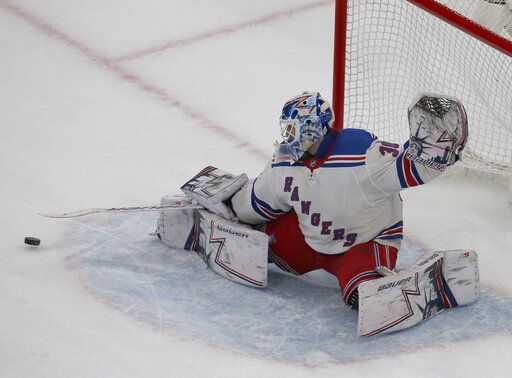 New York Rangers goaltender Henrik Lundqvist (30) makes a save during the third period of an NHL hockey game against the Boston Bruins, Saturday, Jan. 19, 2019, in Boston.