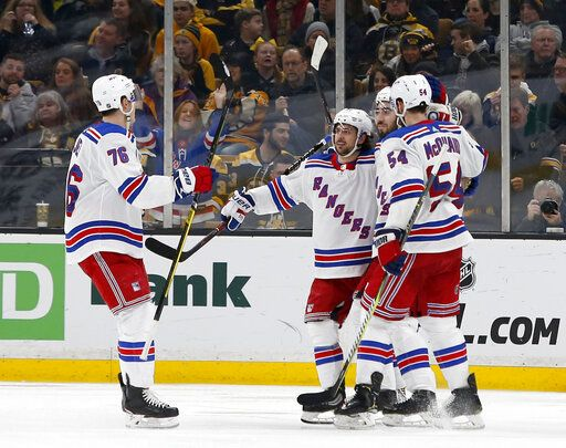 New York Rangers center Mika Zibanejad, second from right, is congratulated by teammates defenseman Brady Skjei (76), right wing Mats Zuccarello, second left, and defenseman Adam McQuaid (54) after scoring a goal during the second period of an NHL hockey game against the Boston Bruins, Saturday, Jan. 19, 2019, in Boston.
