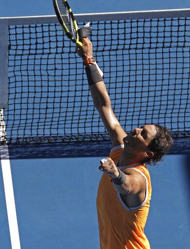 Spain's Rafael Nadal celebrates after defeating Tomas Berdych of the Czech Republic during their fourth round match at the Australian Open tennis championships in Melbourne, Australia, Sunday, Jan. 20, 2019.