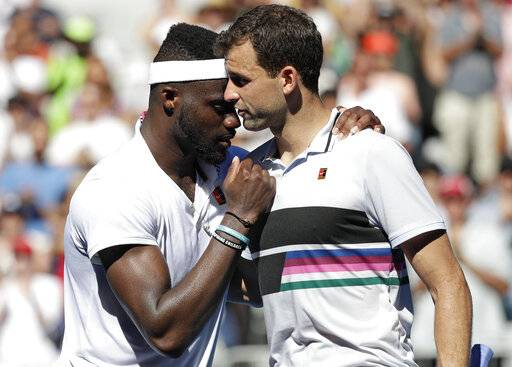 United States' Frances Tiafoe, left, is congratulated by Bulgaria's Grigor Dimitrov after winning their fourth round match at the Australian Open tennis championships in Melbourne, Australia, Sunday, Jan. 20, 2019.