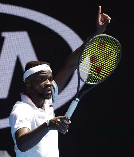 United States' Frances Tiafoe gestures for a video review of a line call during his fourth round match against Bulgaria's Grigor Dimitrov at the Australian Open tennis championships in Melbourne, Australia, Sunday, Jan. 20, 2019.