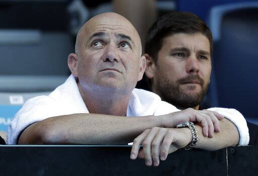 Andre Agassi, coach of Bulgaria's Grigor Dimitrov watches his fourth round match against United States' Frances Tiafoe at the Australian Open tennis championships in Melbourne, Australia, Sunday, Jan. 20, 2019.