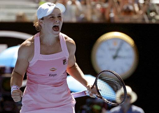 Australia's Ashleigh Barty celebrates after defeating Russia's Maria Sharapova in their fourth round match at the Australian Open tennis championships in Melbourne, Australia, Sunday, Jan. 20, 2019.