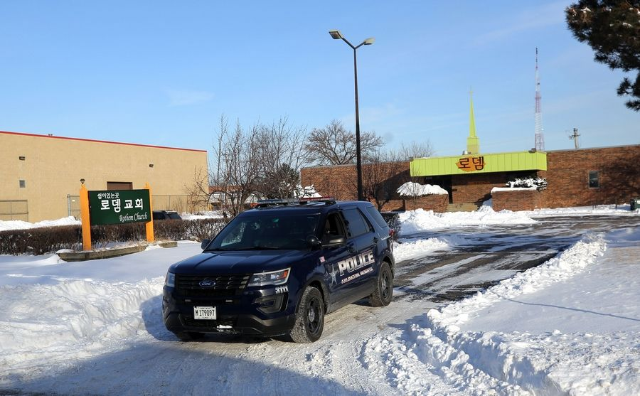 An Arlington Heights police officer leaves the parking lot of Rothem Church in Arlington Heights, where a 12-year-old Elk Grove Village girl died Sunday after a snow fort collapsed on her.