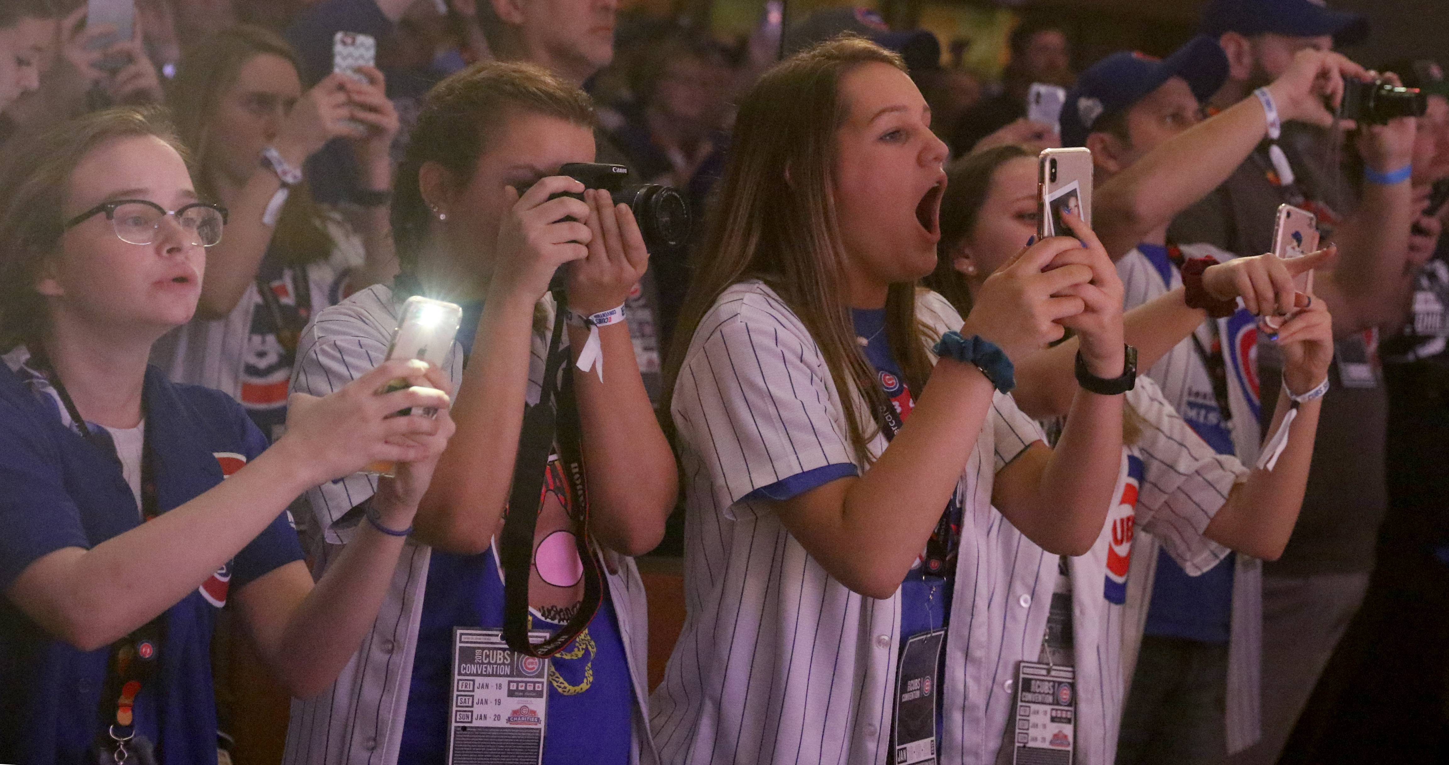 Fans react as players are introduced during opening night Friday of the 2019 Chicago Cubs Convention at the Sheraton Grand in Chicago.