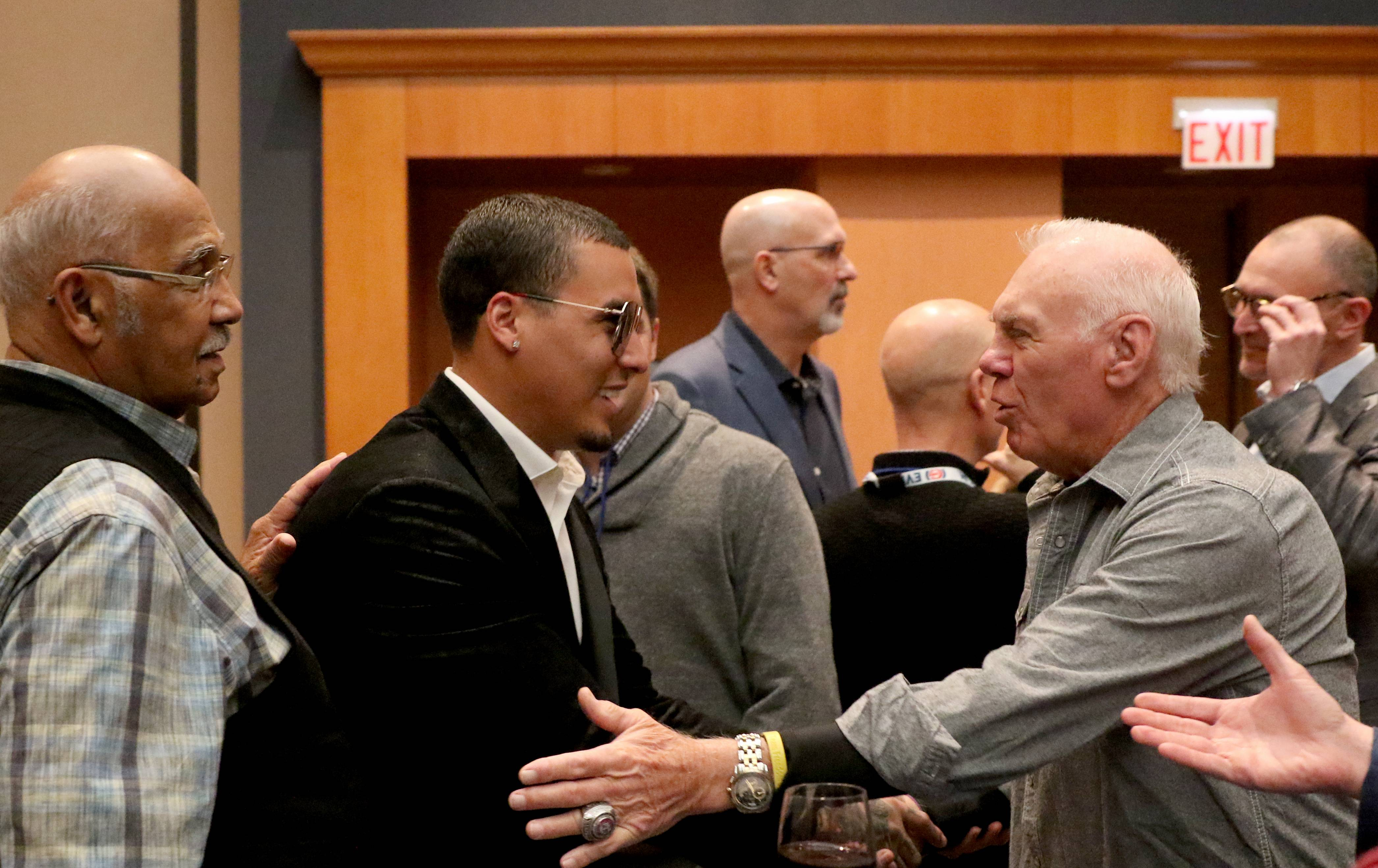Javier Baez, center, greets former Cubs Billy Williams, left, and Randy Hundley, right, during opening night Friday of the 2019 Chicago Cubs Convention at the Sheraton Grand in Chicago.