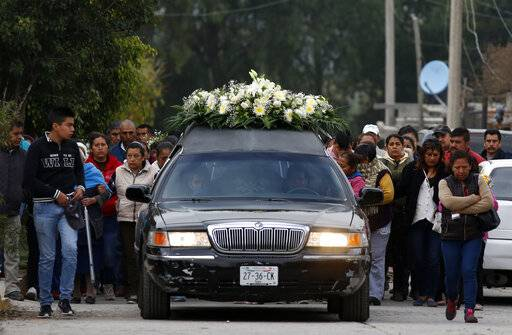 The relatives of Gerardo Preciado Cornejo, who died when a gas pipeline exploded, hold his funeral procession in the village of Tlahuelilpan, Mexico, Sunday Jan. 20, 2019. A massive fireball that engulfed locals scooping up fuel spilling from a pipeline ruptured by thieves in central Mexico killed dozens of people and badly burned dozens more on Jan. 18.
