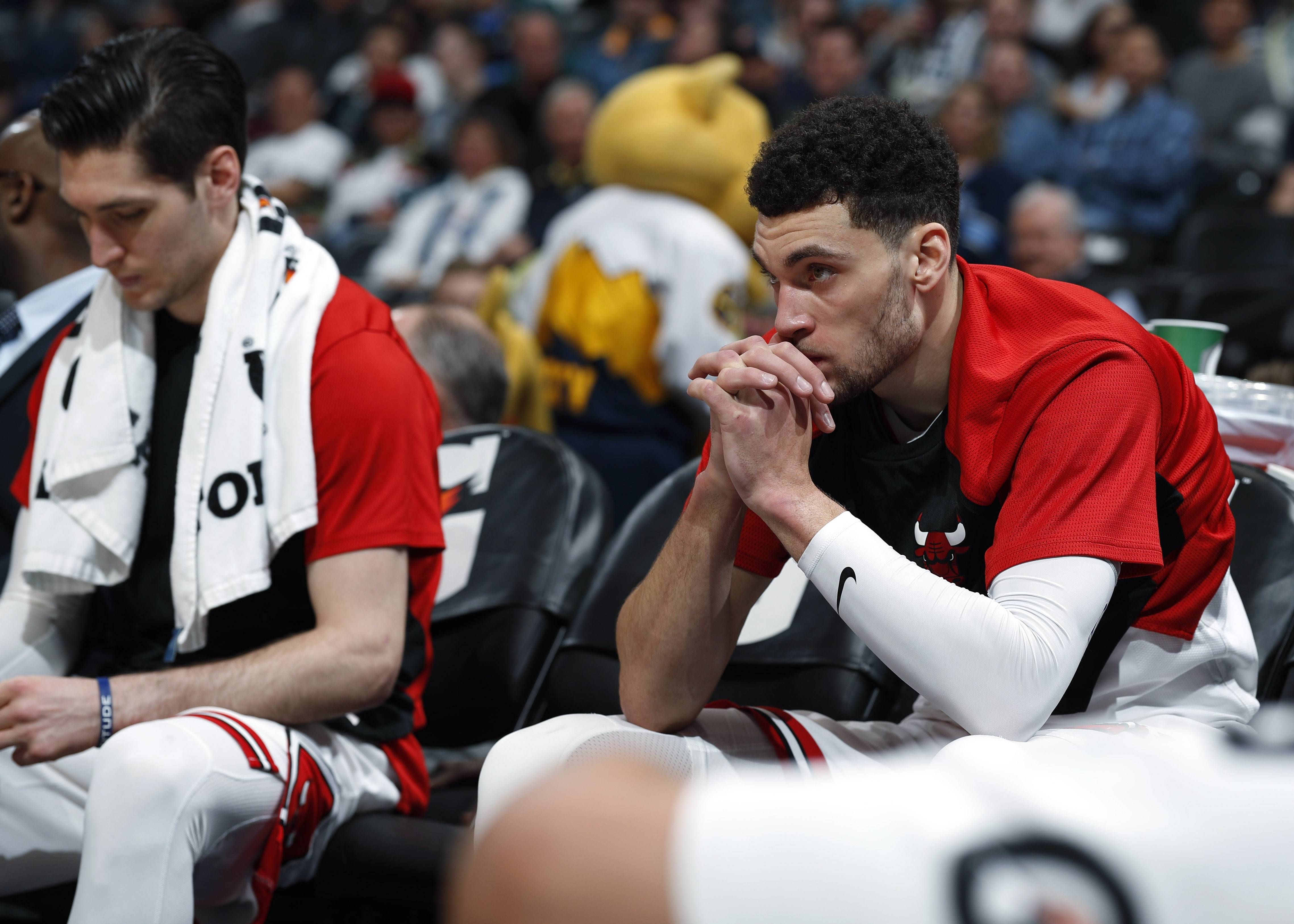 Chicago Bulls guards Zach LaVine, right, and Ryan Arcidiacono sit on the bench as time runs out in the second half of an NBA basketball game against the Denver Nuggets, Thursday, Jan. 17, 2019, in Denver. The Nuggets won 135-105.