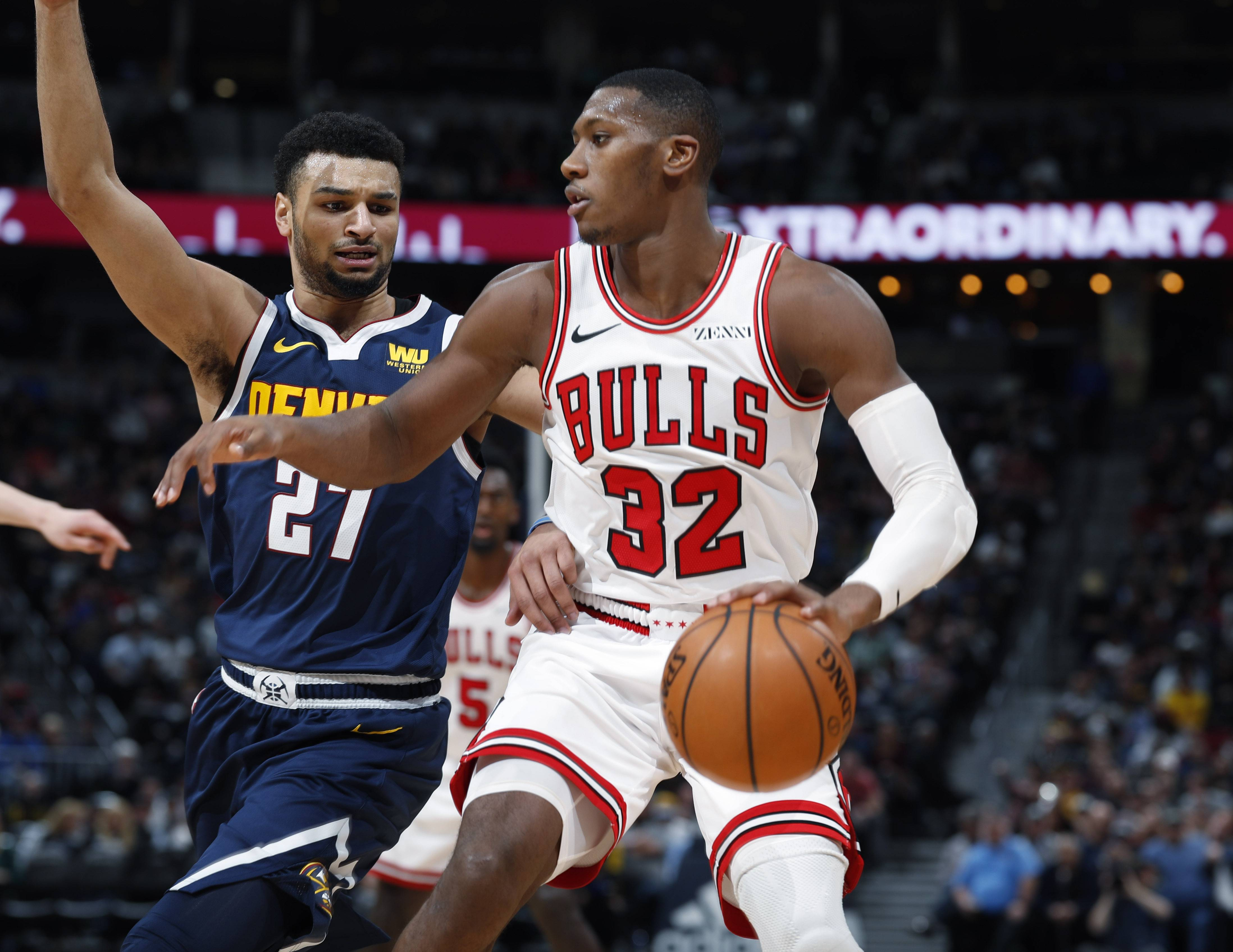 Chicago Bulls guard Kris Dunn (32) works against Denver Nuggets guard Jamal Murray (27) in the second half of an NBA basketball game, Thursday, Jan. 17, 2019, in Denver. The Nuggets won 135-105.