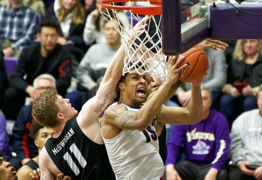 Gonzaga forward Brandon Clarke, right, shoots over Portland guard Josh McSwiggan during the first half of an NCAA college basketball game in Portland, Ore., Saturday, Jan. 19, 2019.