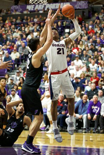 Gonzaga forward Rui Hachimura, right, shoots over Portland forward Hugh Hogland during the first half of an NCAA college basketball game in Portland, Ore., Saturday, Jan. 19, 2019.