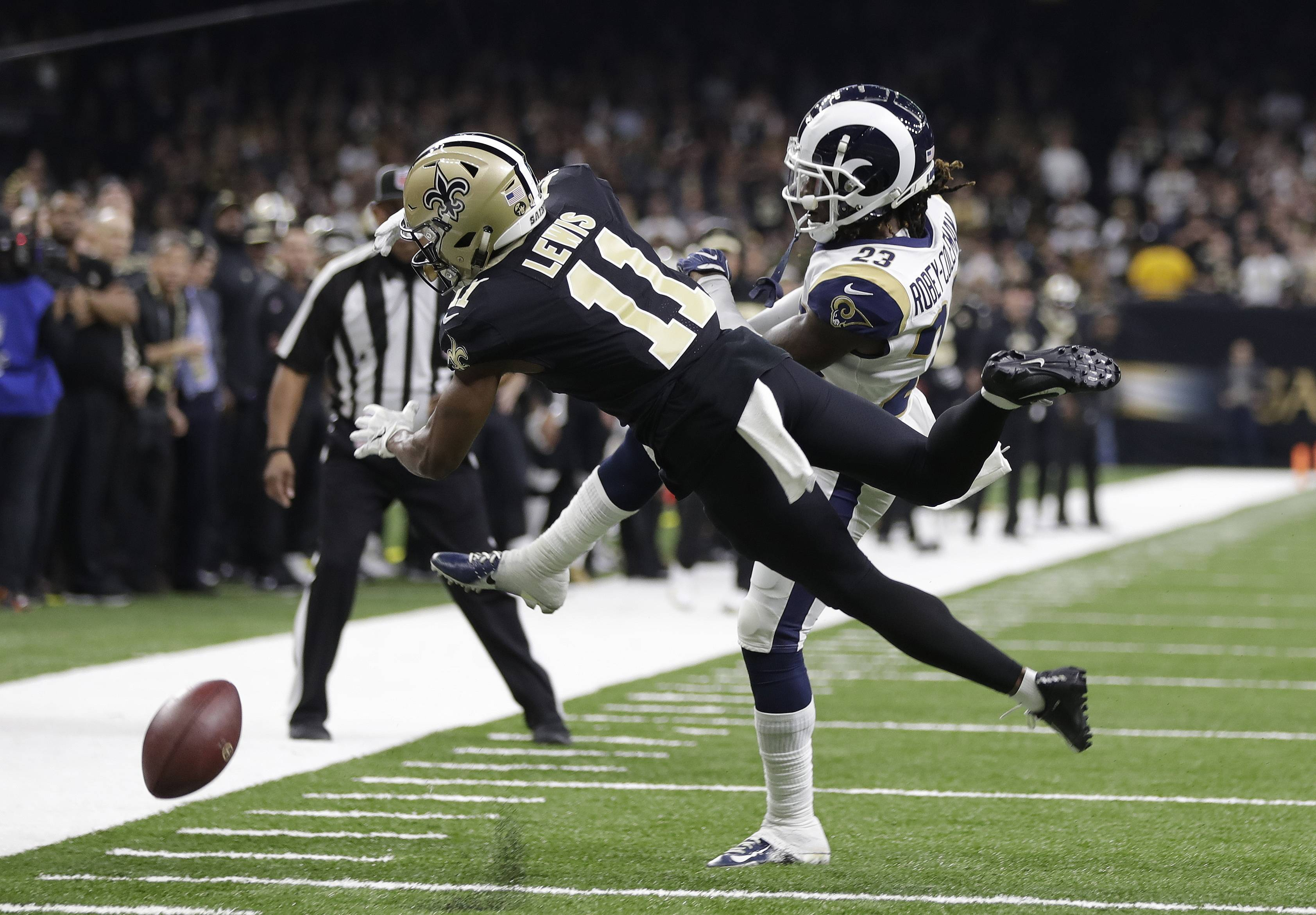 New Orleans Saints wide receiver Tommylee Lewis (11) works for a catch Sunday against Los Angeles Rams defensive back Nickell Robey-Coleman during the fourth quarter of the NFC championship game in New Orleans.