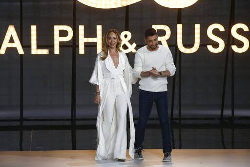 Designers Tamara Ralph, left, and Michael Russo accept applause at the end of the Ralph & Russo Spring/Summer 2019 Haute Couture fashion collection presented in Paris, Monday Jan. 21, 2019.