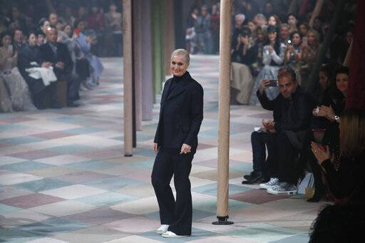Designer Maria Grazia Chiuri accepts applause at the end of the Dior Spring/Summer 2019 Haute Couture fashion collection presented in Paris, Monday Jan. 21, 2019.