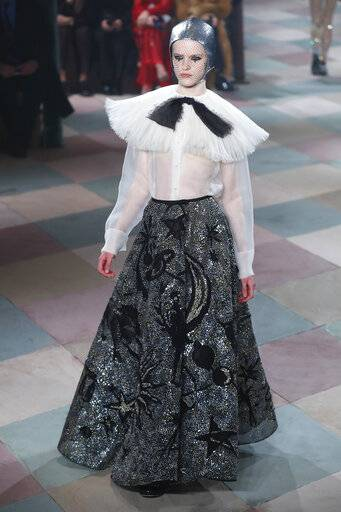 A model wears a creation for the Dior Spring/Summer 2019 Haute Couture fashion collection presented in Paris, Monday Jan. 21, 2019.