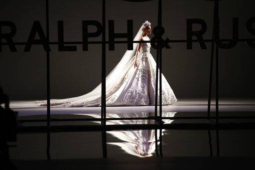 A model wears a creation for the Ralph & Russo Spring/Summer 2019 Haute Couture fashion collection presented in Paris, Monday Jan. 21, 2019.