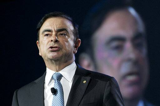 FILE - In this March 23, 2016, file photo, Carlos Ghosn, the Chairman and CEO of both Nissan and Renault, speaks at the New York International Auto Show in New York. Ghosn asked for his release on bail Monday, Jan. 21, 2019, from a two-month detention in Japan, promising he will report to prosecutors daily and wear an electronic monitoring ankle bracelet. (AP Photo/Mark Lennihan, File)