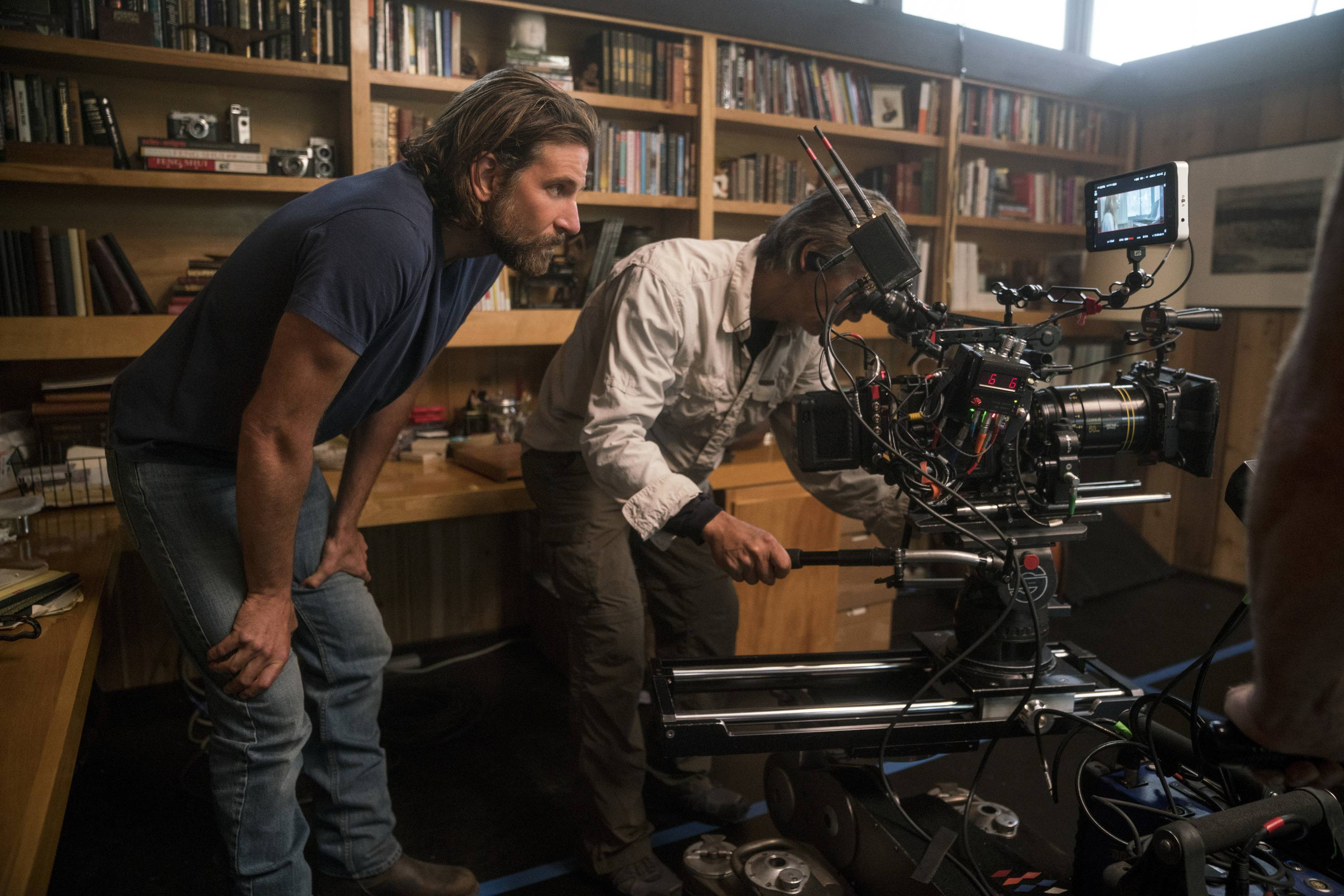 "Director/co-writer/producer Bradley Cooper, left, and camera operator Scott Sakamoto work on ""A Star is Born."" Cooper was passed over for a directing nod when Oscars nominations were announced Tuesday, though he was nominated for best actor and the film is up for best picture."