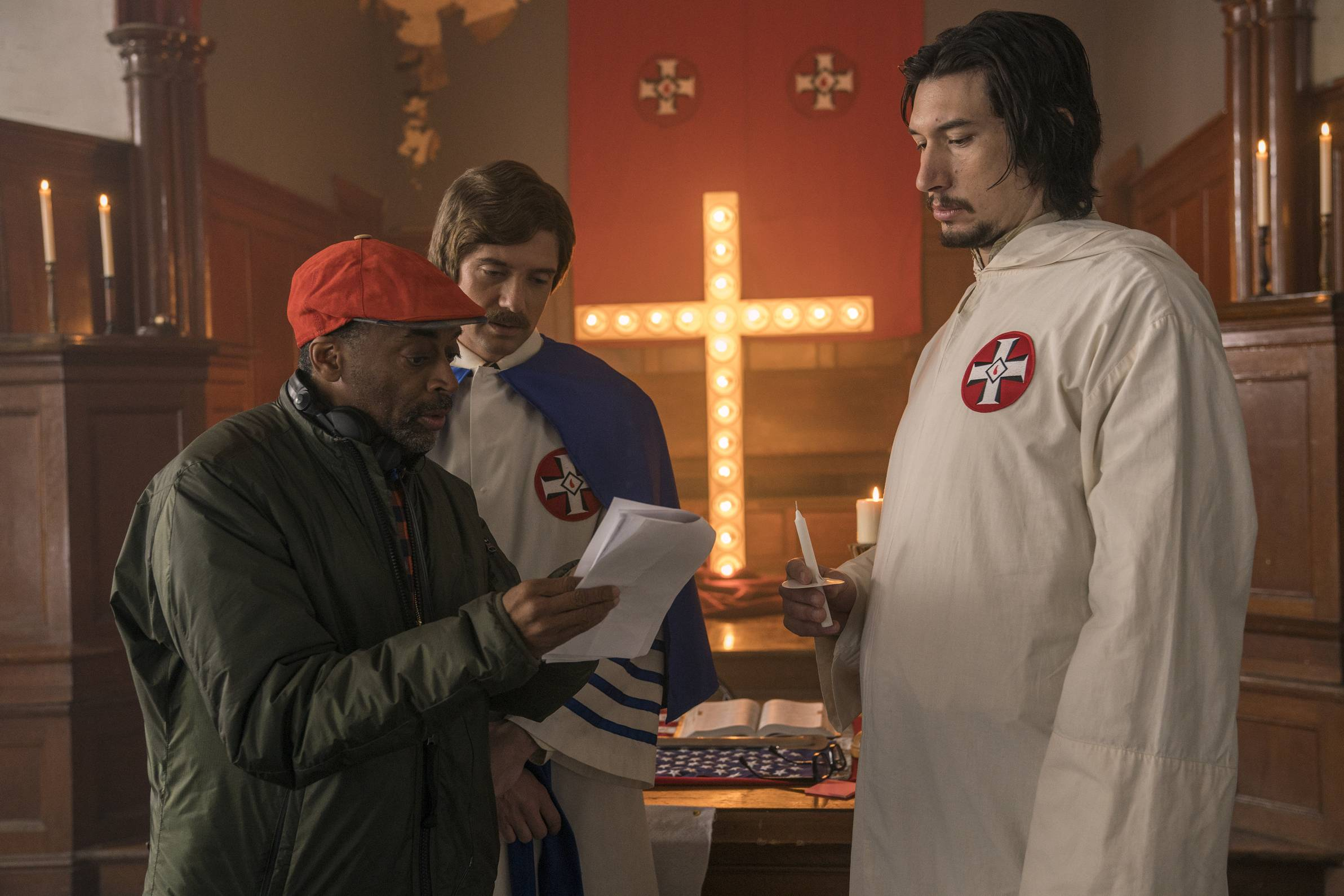 "This image released by Focus Features shows director Spike Lee, left, with actors Topher Grace, center, and Adam Driver on the set of Lee's film ""BlacKkKlansman."" On Tuesday, Jan. 22, 2019, Lee was nominated for an Oscar for best director for his work on the film. The 91st Academy Awards will be held on Feb. 24."