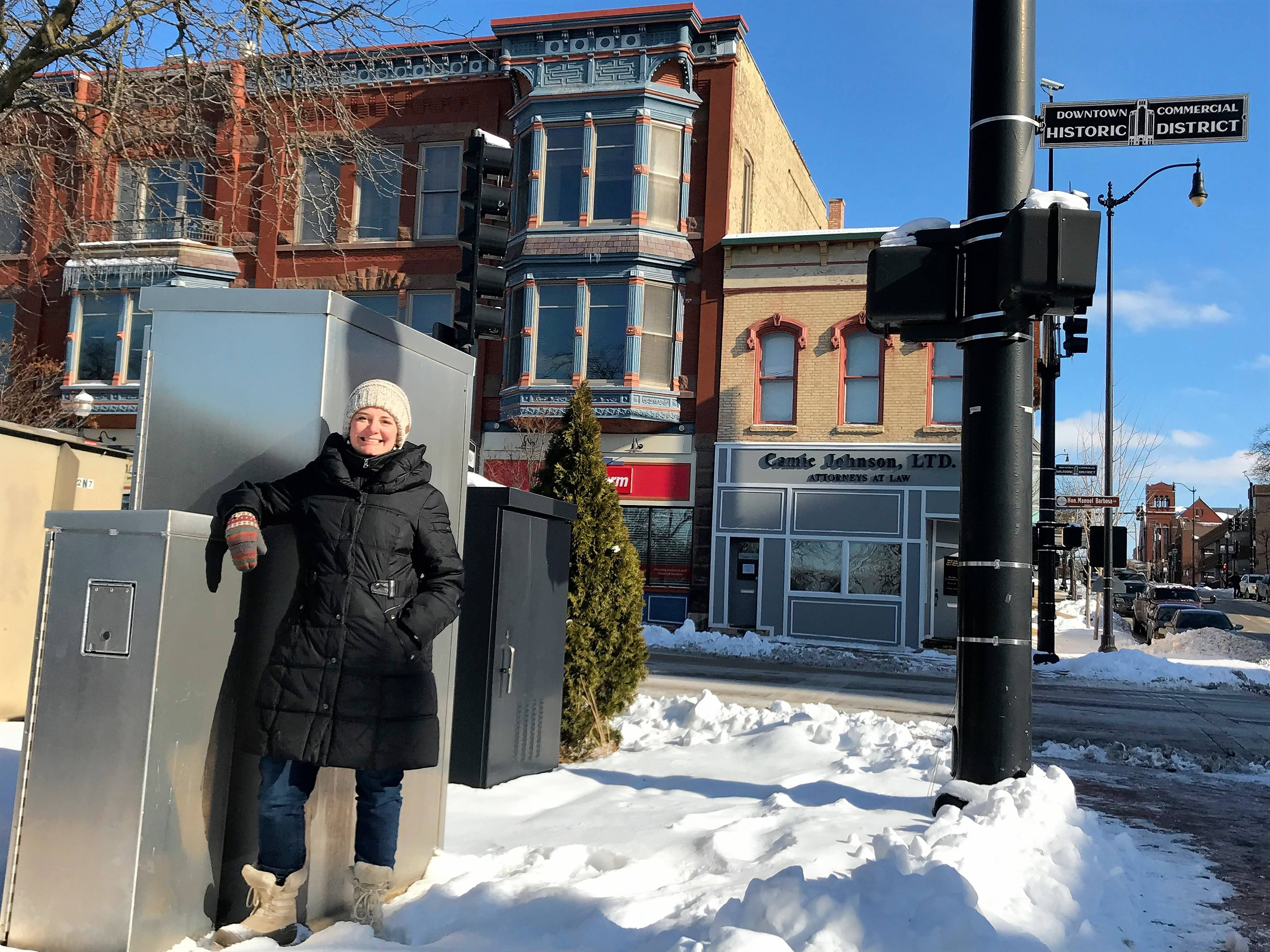 Elgin will be launching a new grant program that will make art out of public utility boxes. Amanda Harris, the city's cultural arts manager, stands Monday near one such box at the corner of Highland and Douglas avenues.