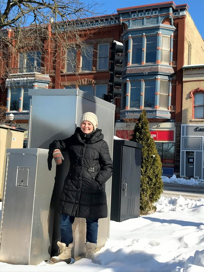 Amanda Harris, the city's cultural arts manager, stands Monday near one a public utility box at the corner of Highland and Douglas avenues. The city is rolling out a utility box wrapping program and a neighborhood public art grant program.