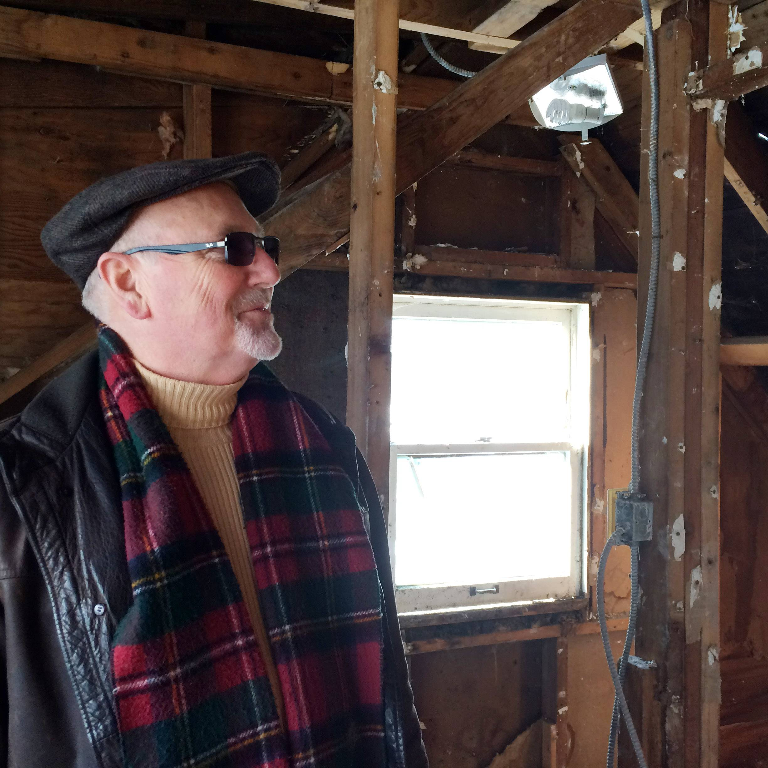 Mike Mader, president the Affordable Housing Corporation of Lake County, views the interior of a Round Lake Park home the not-for-profit organization is rehabbing.