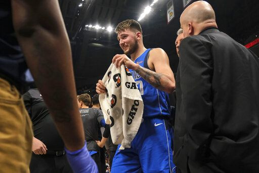 Dallas Mavericks forward Luka Doncic leaves the game after being called for his second technical foul, during the second half of the team's NBA basketball game against the Indiana Pacers in Indianapolis, Saturday, Jan. 19, 2019. The Pacers won 111-99.