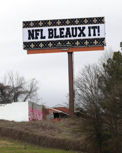 "A billboard protesting a controversial call in the Sunday's NFL football game between the New Orleans Saints and Los Angeles Rams is shown along Interstate 75 near Hartsfield Jackson Atlanta International Airport in Atlanta Tuesday, Jan. 22, 2019. The Los Angeles Rams and New England Patriots will be welcomed to Atlanta for the Super Bowl by several billboards saying ""Saints got robbed"" and ""NFL bleaux it."" WDSU-TV reports Louisiana car dealership owner Matt Bowers paid for 10 billboards across Atlanta through Feb. 3."